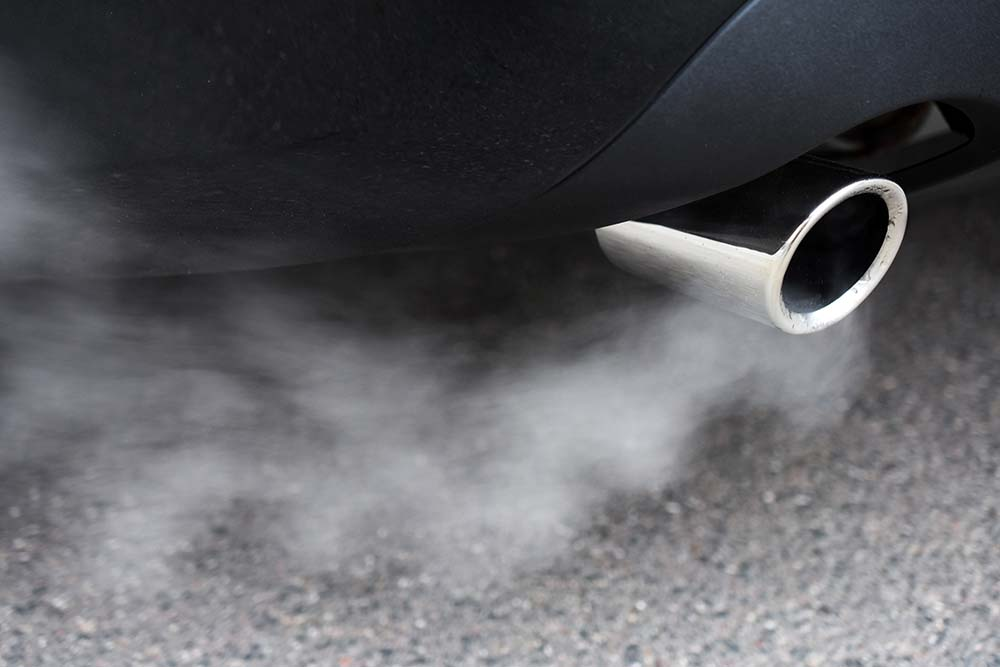 Car exhaust with fumes